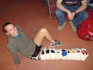 SOLO Wilderness First Responder student shows off her splinted leg.
