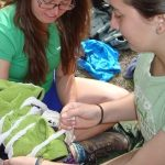 Wilderness First Aid students practice splinting an upper body injury